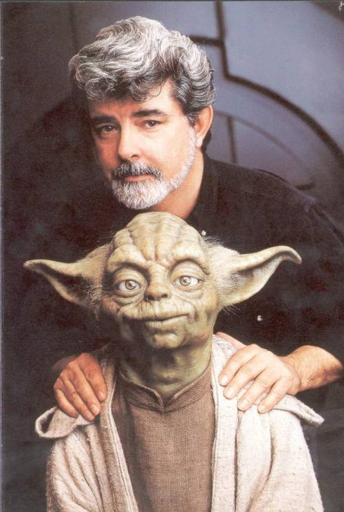 Yoda, ever the friend, covers George Lucas' shame from the camera.