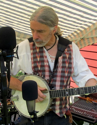 "roosterick:  ""Rooster"" Rick Jackofsky; banjo playing, button maker is blogging about moonshine and old time murder ballads.  Photo by Ed Neale"