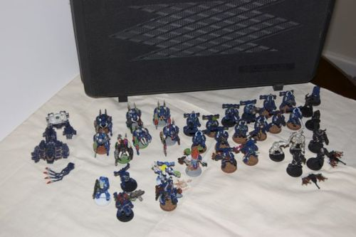 I've got a Warhammer 40,000 Chaos Space Marine army for sale.  Everything you see in the picture, plus the transport case.  Asking $150 for roughly $300 of miniatures.  Haven't had much luck selling it, but now's your chance if you're looking to pick up some minis!  The highlights include a chaos dreadnaught, 7 metal terminators, and at least 10 pewter chaos space marines with some heavy weapons.  It's painted, and can be easily stripped using Simple Green.  Anyone interested?  Email me at greylikestorms(at)gmail(dot)com.