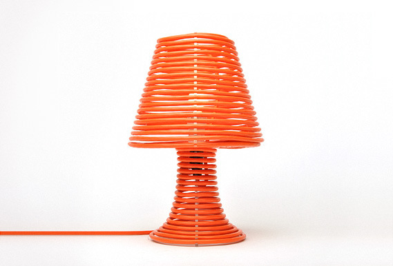 Coil Lamp via Design You Trust  Coil lamp will take you to another level of min­i­mal­ism. It con­tains the  min­i­mum of ele­ments: only laser-​​cut clear acrylic form and a solid  100 foot elec­tric cord wrapped around it. This lamp can be bought at  the site of its cre­ator – indus­trial designer from Chicago Craighton  Berman. There are avail­i­able two vari­ants of lamp: with orange  elec­tric cord or with­out it. The last mod­i­fi­ca­tion allows buyer to  choose color of the lamp by bying cord of spe­cific color by him­self.  More pictures at Design You Trust Available to buy at Gadget-O