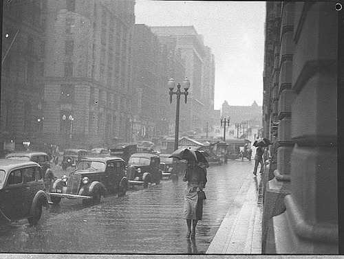 black-and-white:  Rain, Martin Place, Sydney, 1937 / by Sam Hood (by State Library of New South Wales collection)