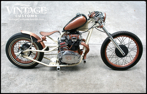"The finished ""Copper Devil"" show bike.After a year in the making and nearly another year sitting, the Copper Devil is at last finished and running. There is so much detail and one-off fabrication on this bike, including the custom one-off frame built by me, Jay of Vintage Customs, 'devil horns' pipes, one-off handle bars, rear hand-brake, seat pan and leather work, copper rear fender by 7 Metal West, 21"" front wheel on mid 80's Suzuki forks, rear 16"" Yahama wheel with a double white wall Shinko tire and much more!"