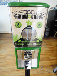 Our Seedbomb Machine! Made  from a mixture of clay, compost, and seeds, seedbombs are a great way  to combat the many forgotten grey spaces you encounter everyday: from  sidewalk cracks, to vacant lots and parking medians. They can be thrown  anonymously into these abandoned urban sites to reclaim and transform  them into places worth looking at and caring for.