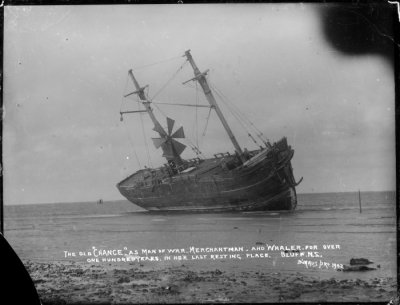 "Sailing ship Chance, aground at Bluff, NZ 1902 showing wind powered electric generator The old ""Chance"", as man of war, merchantman, and whaler for over one hundred years. In her last resting place. Bluff, N.Z. Dry plate glass negative Reference No. 1/1-001999-G De Maus Collection, Alexander Turnbull Library, National Library of New Zealand"