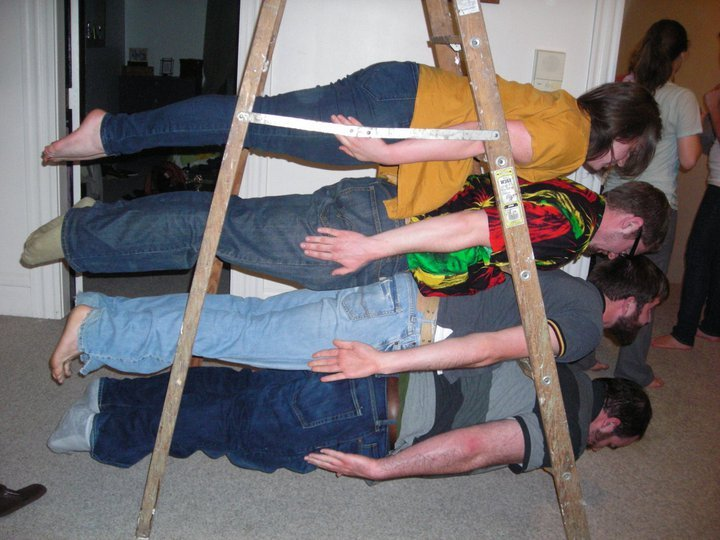 Lots of people doing the Ladder Plank