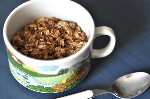 "hipsterfood:  do-it-yourself granola buying gourmet*~ granola is super expensive, and there usually aren't a lot of good vegan options. (most include honey or powdered milk.) i had to try to make my own! the thing about granola is that it's so flexible, you could add just about any kind of substitute for any of the following ingredients, and it would be great no matter what. another thing, the ratios here are pretty flexible as well. i kind of just did it as i went along, and it turned out great. don't take anything here too literally, try different things out and see how it works for you. in a big, sealable bowl, mix together: 2 cups ground oats (i ground rolled oats in a coffee grinder, you could also try grinding it in a food processor) 2 cups rolled oats, whole 1/4 cup ground flax seed 2 tbsp chia or sesame seed 1/4 cup raw sunflower seed 1 cup unsweetened corn or bran flakes 2 cups chopped dried figs 1 tbsp flour then add in: 1 1/3 cup mixture of liquid sweeteners (i used maple syrup, agave, and molasses) 2 tsp vanilla extract close your bowl with its lid, tightly, and shake everything together. check to see if the sweeteners are uniformly spread throughout the mixture - there should be clumps, but not big clumps of sugar :p  once you've decided you've got a good ratio of ingredients (you might want to add in more sweetener, more oat ""flour"", etc, depending on how you like your granola), spread everything out on a baking sheet. bake in a 350F oven for about 20-30 minutes, stirring occasionally. keep it in until everything is a little crispy and brown, but take it out if it seems like it's browning too quickly! let it rest for 10-20 minutes after taking it out of the oven. keep stored in an airtight container, and add in dried fruit & nuts when you have it for breakfast (or any meal of the day, really.) enjoy!"