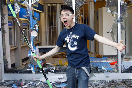 Wow. Didn't know hockey can get a Chinese kid angry. (via vancouver knows how to riot! | angry asian man)