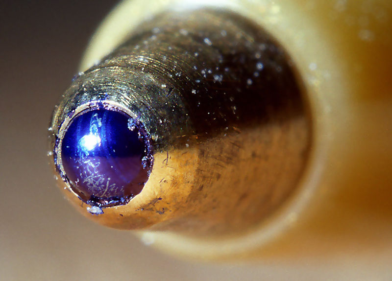 Tip of a ballpoint pen highly magnified.