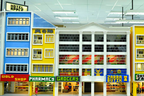 latimes:  A behind-the-scenes look at the planned Legoland Malaysia. Photo: Lego models of the storefronts along Jalan Wong Ah Fook, one of the busiest roads in the city of Johor Bahru, planned for Legoland Malaysia. Credit: AFP/Getty Images