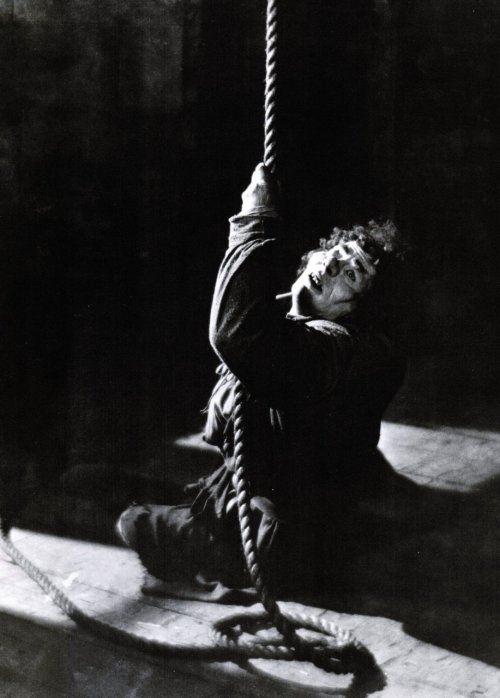"Lon Chaney in The Hunchback of Notre Dame (1923, dir. Wallace Worsley) (via) ""There dwelt within the rocky fastness of the cathedral a creature whom the Parisians of that day knew as the 'Hunchback of Notre Dame'. Quasimodo. Deaf, half-blind - shut off from his fellow men by his deformities, the bells were the only voice of his groping soul. To the townspeople he was an inhuman freak, a monstrous joke of Nature - and for their jeers he gave them bitter scorn and hate."""