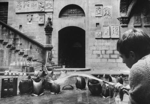 Flood damaged suits of armor being washed. Source: LIFE
