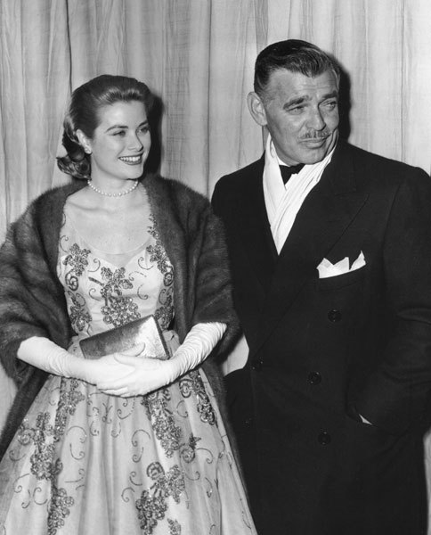 Grace Kelly & Clark Gable, 1954 drdre711:  Clark Gable, 53, arrives with his 24-year-old Mogambo costar Grace Kelly who was nominated for Best Supporting Actress but lost to Donna Reed