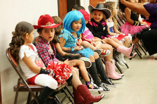 "spratt:  Contestants in the ""Little Miss Fourth of July"" competition wait at Las Palmas Community Center, Saturday, in McAllen, Texas. 