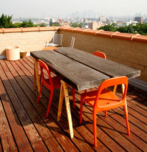 "visualid:  VisualiD's Pick on everyday living. Cool rooftop with ""URBAN"" chair in orange from IKEA and a homemade table in Wood."