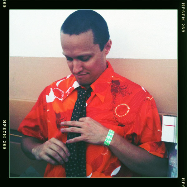 Singer/songwriter Ryan Montbleau tries on his new Virginia before a gig.