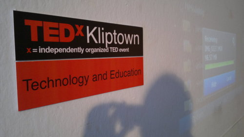 "tedx:  TEDx in a Box in Soweto - TEDxKliptownAt TEDGlobal 2010, TED and Nokia launched an initiative called TEDx In a Box. The idea being, to enable people in developing communities to host TEDx events using the technology supplied in the Box. How the box works is that you have two Nokia N8 phones, Nokia MD-8 speakers and an Optoma PK201 Pico Projector. With these, you should be able to play TEDTalks (which are preloaded) and also record live speakers at your TEDx event.TEDxSoweto became the first recipient of ""the box"" in South Africa. We looked at the different parts of Soweto and decided to focus on Kliptown. Established around 1903, Kliptown is the oldest residential settlement in Soweto. Today approximately 80% of its 45,000 residents still do not have running water, basic sanitation or electricity. The community does not have a school, and children have to travel long distances to attend school in other parts of Soweto.In looking for community members to work with, we found a youth development programme (Kliptown Youth Project) that runs a tutoring program for kids, a library, a feeding scheme and has a community hall that is equipped with one solar panel and a generator. The project has 300 XO computers from the One Laptop Per Child (OLPC)program.We hosted a half a day workshop with members the youth project to get a better understanding of the community needs. At the end of the day, we agreed that education is their number one priority. The theme for the event became Education and Technology.On the 28th May 2011 we hosted TEDxKliptown with 4 speakers, a dance performance and 40 attendees.Selecting which TEDTalks to play was easy. Almost everyone who was at the event knew of Professor Nicholas Negroponte and MIT. We played Nicholas Negroponte's One Laptop Per Child talk and Pravan Misty's Sixth Sense talk. As far removed from MIT as Kliptown is, the young people who are direct beneficiaries of the OLPC project could not only relate to Negroponte's talk but could also see the possibilities thatMistry's sixth sense technology presents.The speakers were all part of the Kliptown story:Hannah Weber is a student at Dartmouth College but originally from Boston, Massachusetts, USA. She first visited Kliptown in 2005 when she was 15 years old. Getting back to Boston she and her sister raised funds to buy 100 XO computers from the OLPC organisation and sent them to the Kliptown Youth Project. Since then, the project has managed to get 200 more computers. She talked about finding hope in Kliptown and how she has witnessed the difference the project has made in the livesof children in the community.Thulani Madondo is the founder of the Kliptown Youth Project. After his studies, he wanted to make a contribution to his community. Together with other young people they started the project and never looked back. Through this he is currently assisting other projects in Rwanda and Swaziland to implement their OLPC programmes.Simphiwe Mthembu was one of the first beneficiaries of the XO computer when they first arrived in South Africa in 2008. She attributes her success to having been exposed to the XO computers and understanding technology better.Shelley Bragg works as a marketing consultant for the International School in Shanghai China. When her school wanted to start a gumboot dance project, she remembered visiting a community in Soweto where the kids were very good gumboot dancers. How can she bring them to Shanghai? She quickly remembered that the kids also had XO computers which were internet enabled and if she linked them to the school via Skype, then her students in China would understand. After severalSkype gumboot dance performances, the Kliptown Youth gumboot dancers were able to visit Shanghai and Beijing.The technology in the ""Box"" had its challenges, but ultimately delivered a great event.With one phone, you can show TEDTalks and project them to a white surface. The Nokia speakers are good for an audience of up to 30 people. The TEDTalks are pre-loaded onto the phone or you can upload new talks directly from TED.com using Wi-Fi or wireless 3G Technology provided by your local cellular phone company. The 16GB memory on the phone makes it possible to store up to 30 TED Talks. You can then use the second Nokia N8 phones, to record live speakers.Like any TEDx event, some of the speakers had power point presentations and wanted to show video clips. We had to transfer the presentations and video clips from their laptops to one Nokia N8 phone via Bluetooth. The speakers could then use the phone to run through the presentations and play their clips. We then used the second phone to record the talks.  The next process is to edit all that into seamless TEDxKliptown talks.The challenges? Well the battery life on the N8 phones is relatively ok. You can play up 6 TEDTalks or record four 18 minutes presentations. After this you need power supply. The Nokia MD-8 speakers did not work very well. Thanks to my Jawbone Jambox that I received in my TED 2011 gift bag we had backup speakers. Unfortunately the Optoma Pico Projector could only work for one hour without powersupply. The venue had a power source that we could use.For the first time, we were able to demonstrate to the community of Kliptown that cellular phones and the use of mobile technology has a potential to transform their community. In the past hosting such an event might not have been possible without computers, electricity, sophisticated filming equipment and a big budget. With TEDx in a Box, the community was able to finally watch Professor Negroponte talk ,witness how the XO computers have transformed their lives and begin to imagine what else is possible.The total budget for the event was $200 which was mainly for coffee, biscuits and printing costs.We decided that we will host bimonthly TEDxKliptown events starting again in August 2011 and are looking at possibilities of rolling out the project to other parts of South Africa that have similar challenges like Kliptown.Written by Kelo Kubu, TEDxSoweto Organizer and TEDx Africa Ambassador"