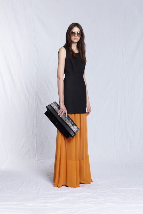 maison martin margiela resort 2012.  love the skirt and oversized envelope clutch!