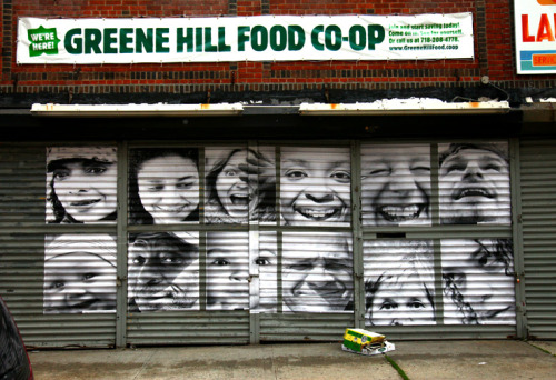 "JR's global project ""Inside Out"" on the gates of the Green Hill Food Co-Op, where a huge neighborhood community reception was held Friday night to celebrate the new installations here."