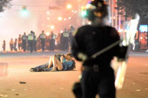 During the riots after the Vancouver Kunucks lost the NHL Championship. He was comforting her after being beaten by the police. What a iconic photo. There will be posters of that at some point.