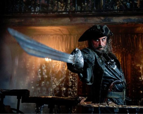 Ian McShane is a dwarf in Snow White And The Huntsman Ian McShane has landed the role of dwarf leader Caesar in Snow White And The Huntsman.Just one of the myriad Snow White films currently in development, Huntsman is being set up over at Universal and already boasts an impressive cast.Kristen Stewart is playing the titular beauty, Chris Hemsworth the Huntsman, and Charlize Theron the evil queen whose jealousy tumbles Snow White into a dangerous adventure.