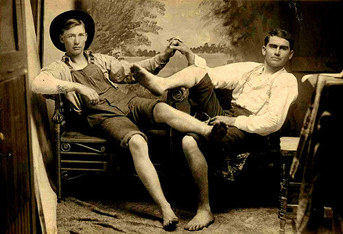 Date unknown Two men expressing their friendship with overt   touching. (via Nueva Sam)
