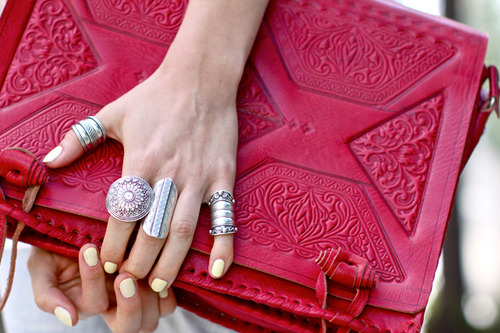 The power of a clutch, lots of rings and bright nails.