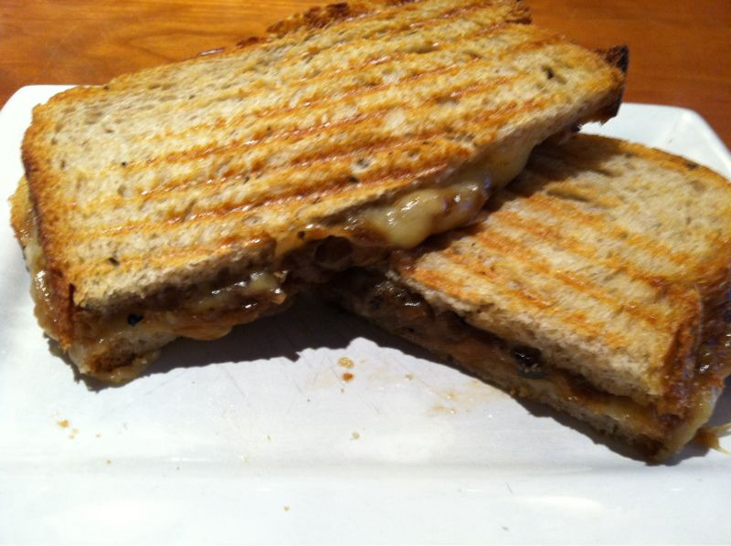 Melted gruyere cheese and caramelized onions on pressed rye toast A- Wichcraft