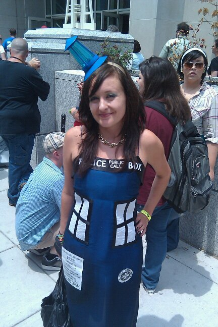 I've seen some fine TARDIS dresses in my day, but this one takes the fish fingers and custard (aka cake).  Photo by Chris McElheny at Wizard World Philadelphia. If anyone knows the cosplayer let me know so I can credit her. She's been found! It's @geekadelphia blogger @JoPincushion! Who is also on Tumblr! And Emily Tullis designed the dress for her: emilyetullis [at] gmail [dot] com
