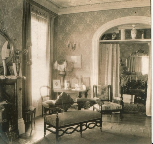 "Interior of a Victorian home. The reverse of the picture says ""Learning Room""."