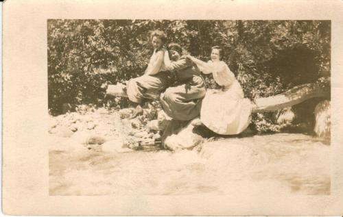 "Postcard of girls having fun! :) Postmarked October 14th 1909. The reverse reads: ""Dear Ralph- The first lady sitting on this log is a merry widow. The other two are old married ladies.Ray wrote me that Geo. Greenwood was recently married to a Miss Anderson. When you come to California, you must stop at Redlands and see the Archers. Love to all the Ladds. May."" It is addressed to Mr. Ralph Ladd,Memphis, Mo."