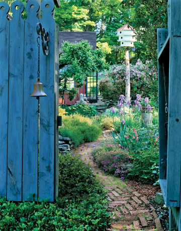 I love the blue garden gate. (via Charming Connecticut Garden - Country Living)