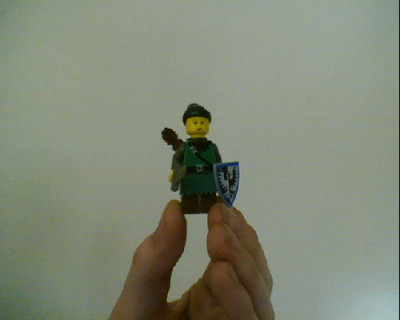 This is how to make a lego link minifig without any costumization. I dont think you need steps, so I will just say what pieces you need. A robin hood shirt, new one or old one, I only have the old one brown pants hula skirt  normal sword black falcon shield arrow holder malfoy face and a green pirate bandana. Now put it all together!