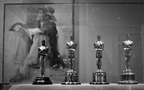 Foreground: Katharine Hepburn's four Oscar statuesBackground: Katharine Hepburn by Everett Raymond KinstlerNational Portrait GalleryWashington, DC11 June 2011