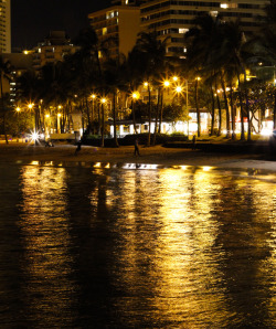 Waikiki at night.  Didnt have a tripod so i put it on my camera bag.