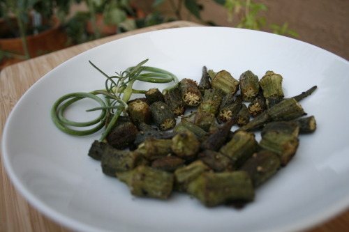 Roasted okra. okra + olive oil + salt & pepper + 425°F for 10 minutes = delicious. I feel lucky since many people have told me they have had bad luck with growing okra, and our little okra plants are doing great out in the garden! I saw this okra at the grocery store though and got excited, so I decided to try out an easy recipe that I can use once ours are ready to harvest. Who ever thought of roasting okra? Not me, but it's a winner for sure!