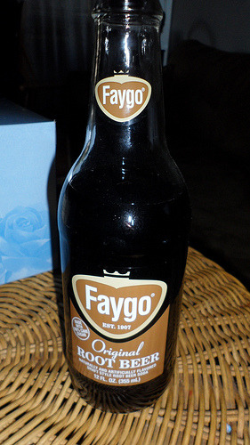 001. FAYGO My very first beverage review features FAYGO! Recently I got into the webccomic Homestuck. For those who aren't  familiar, there's a character, Gamzee, who, while an alien, is based on  the Juggalos, better known as fans of the group Insane Clown Posse. To  that end, Gamzee drinks, by the two-liter, a brand of soda called Faygo,  which is particularly popular among Juggalos. Being a huge Homestuck fan and with Faygo becoming an in-joke not  just among Homestuck fans but with a group of my friends as well, I felt  it was my duty (and okay, a bit of a fan-obsession) to check this stuff  out. About Faygo: Faygo is a Detroit-based soda company, founded by Ben and Perry  Feigenson in 1907. Starting with fruit punch, grape, and their famous  strawberry (Red Pop), Faygo now comes in over fifty flavors (including  diet versions of many of their favorites) and is distributed in Canada  and the Midwest, Mid-Atlantic, and Central Southern regions of the  United States. Alas, Faygo is not yet distributed in California, so for me, finding  it comes down largely to specialty stores like BevMo. And lucky for me,  the grocery store just down the street also happens to carry a few  flavors of Faygo. I could also order many flavors online, but I haven't  done that yet as the shipping costs are pretty prohibitive. At any rate, with a little hunting, I managed to come up with six different flavors of Faygo to try. Faygo Red: Hit! This strawberry soda is a bit  creamy, making it sort of a mix between strawberry and crème soda. Very  good, and worth getting again. Faygo Orange: Hit! Fairly typical orange soda, I suppose. Just good stuff. Faygo Grape: Hit! Much like the orange, it's fairly standard grape soda, but it's good. Like a melted popsicle that's been carbonated! Faygo Creme Soda: Miss :( I honestly couldn't drink  it, and god knows I tried. It has a very strong chemical taste and I  only manage two sips before I was forced to give up. Faygo Rock & Rye: Hit! It's an unusual flavor,  sort of between root beer and crème soda, something like sarsaparilla,  but stronger in the rye flavor. That said, it's very good and I'll  definitely be buying it again. :D Faygo Root Beer: Hit! Oh, My. Gosh. This is very  possibly the best root beer I've ever had. It's addicting. An absolute  must-have and a now frequent purchase! Overall, Faygo is a brand that delivers sugary goodness for a cheap price. With one exception, I've loved everything I've tried!