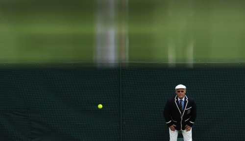 LINE ITEM   A line judge kept an eye out Tuesday at Wimbledon.  (Photo: Tony O'Brien / Action Images / Zuma Press via the Wall St. Journal)