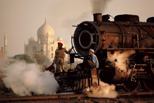 "Men on a train outside of the Taj Mahal, India This photo was taken by photographer Steve McCurry, the man who captured the famous green eyed ""Afghan Girl"" for National Geographic in 1985 (via 22 Incredible Photos of Faraway Places - My Modern Metropolis)"