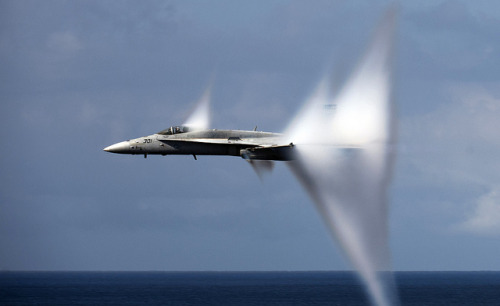 Whoa. usagov:  Image description: An F/A-18C Hornet breaks  the sound barrier during an air power demonstration over the aircraft carrier USS Carl Vinson. Image from Official U.S. Navy Imagery on Flickr.