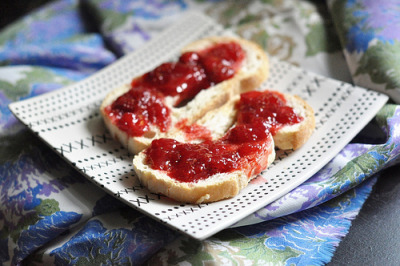 hipsterfood:  make your own strawberry jam this is the simplest version of strawberry jam i could find, and i'm glad i tried it!  i couldn't have made this delicious spread without the help of this guide. this post is based off of that one, except i'm not going to go through the whole canning process, or give you a pectin version and a sugar free version. go there to see that! first, thoroughly rinse and de-stem four cups of strawberries. i cut mine in halves and quarters, as well, to make them easier to break apart later.  squash all of the berries with your hands, until this consistency:  you can break them apart even further, but i like my jam to have pieces of berry in it. don't leave the berries fully whole, though. when you break them apart, the natural thickeners in the fruit come out more easily, giving you a thicker jam. from there, add in two cups of sugar. i used beet sugar because it's the closest thing to white granulated sugar we have on hand. put your pot on the stove and turn the heat to medium. once the sugar is fully dissolved, let it boil for a minute or two, continuing to stir. using a cold spoon (leave it in some ice water while you're stirring the pot), spoon out some strawberry liquid. let that sit for a minute, and see how gelatinous your mixture has become. check the guide to see what to do if it's still very liquidy. if it's a good consistency, turn off the heat and let the pot sit for 15-20 minutes. stir, and pour into your containers. 4 cups strawberries will make a good amount of jam - we got three small/medium sized jars.  you can leave the jam in the refrigerator for a week or so, but try to use it as soon as you can. we'll be making a few recipes in the next week for ideas as to how you can use all this jam. try out this pretty easy staple, and see how it works for you. good luck!