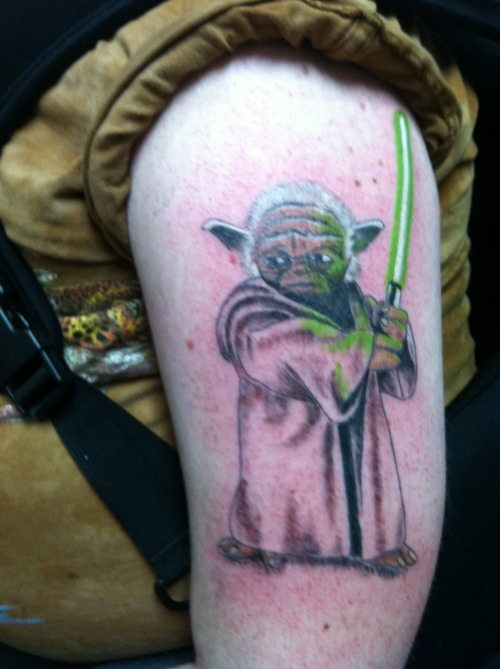 YODA is my favorite movie character of all time. I'm a huge STAR WARS fan. A.S.I. TATTOOS in Salt Lake City is where I got it done. If you ask me, they did a kick-ass job!