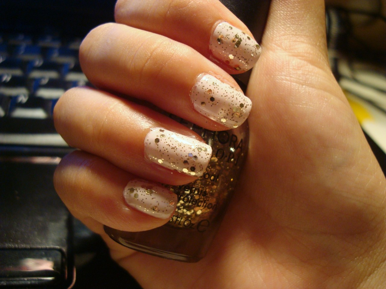 My nails right now :]  Essie FijiSephora by OPI Only Gold For Me Topcoat
