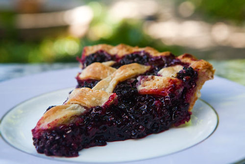 I made blackberry pie for Father's Day so easy and good!   Easy family recipe I have been using forever! Recipe by Catherine Rex   Ingredients  2 Marie Calendar crusts (They come in a pack of 2 at my local market.  This crust taste great and saves you the hassle of having to make your own J ) 5 cups of fresh or frozen Blackberries or Boysenberries (Boysenberries are my favorite) 1 cup sugar (Boysenberries tend to be sweeter so you may be able to use less sugar with them) ½ a lemon juiced Lemon zest ( ½  a lemon) 1/4 a cup of tapioca butter Method 1)   Mix blackberries, sugar, lemon juice, lemon zest, and tapioca in a bowl. 2)   Put mixed berries into the bottom piecrust and add some dabs of butter around the top of the berries. Then add on the top piecrust, pinch the edge with your thumb and forefinger, and cut some slits in the top crust. (You can get creative with the slits if you want stars are always fun, but plane slits made with a knife will work too) 3)   Bake the pie in the oven at 325˚ F for about an hour or until the crust looks golden. (If it seems to be cooking too slow raise the temperature to 350 ˚ F)