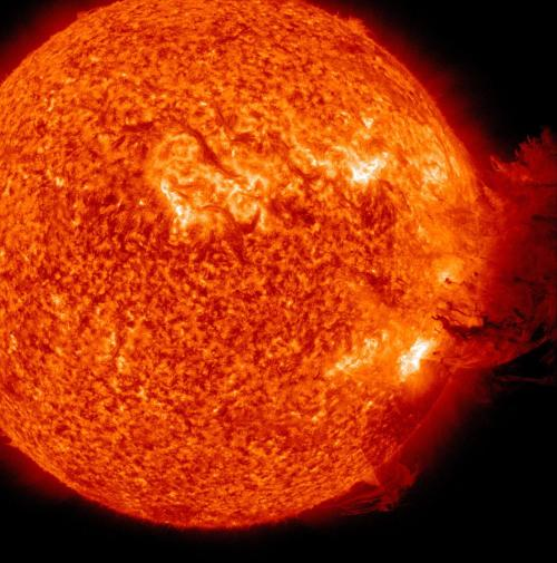 "A Coronal Mass Ejection from the Sun as viewed by the Solar Dynamics Observatory (2011.06.07).  ""The Sun unleashed an M-2 (medium-sized) solar flare, an S1-class (minor) radiation storm and a spectacular coronal mass ejection (CME) on June 7, 2011 from sunspot complex 1226-1227. The large cloud of particles mushroomed up and fell back down looking as if it covered an area of almost half the solar surface"" - NASA"