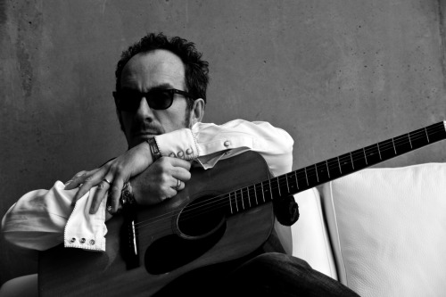 "Bad Ass : Elvis Costello. AND The Imposters. SAY WHAAAAHHH? I had to score me some THIRD ROW SEATS!! North Charleston Performing Arts Center, July 18th. A birthday present. YAYEH! AHHHHHH I AM PSYCHED.  Elvis C, now on heavy itunes rotation…..brushing up on the lyrics. I am not going to be that nerd singing incorrect lyrics. Nor will I be the guy who only sings ""Allison"". i kid. but seriously like whats the deal on taking pictures at this venue, does anyone know? No flash? No camera? No nothing? NO WAY just kidding, the tix were $150 each.  ARE WE CRAZY? Elvis better serenade me. No, not me…Erin. Yeah, Erin. HAAH! Buy your tix NOW.  Dont sweat it….I'll look back and wave. Im bringing opera glasses to peer towards your seats, behind me. http://www.northcharlestoncoliseumpac.com/events/detail/elvis_costello_the_imposters In like 19 ninety sumthin' I saw Elvis at The Beacon, thirteenth row center left. Nothing compares to seeing a legendary band live, for the first time, not knowing what you are about to see and hear. That discovery of music is like a drug to me. I am nowhere near the halfway point of my 19,000 song itunes collection. AND I DONT WANNA HEAR HOW YOU HAVE MORE THAN ME. I know my collection isnt ""the biggest"". But it is my mountain. That I built. And I am crossing.  - jn"
