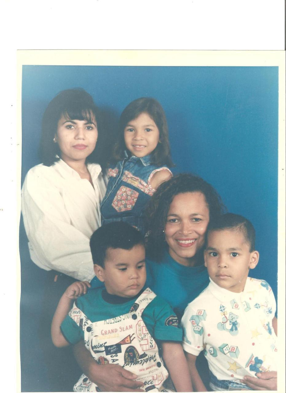 My mother is the one holding my sister, and I´m on my aunts lap with my brother. -submitted by ifellinlovewithmsparker