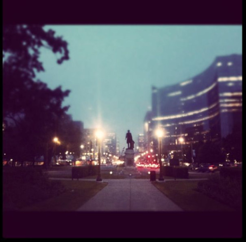The Fog. Toronto right after sunset.  This is taken at Queen's Park, at the on coming traffic towards Canada's first Prime Minister Sir John A. Macdonald.  Can you see the momentum of the city but feel the lull of the fog, the glow of the street lamps.  Stand still and embrace your surroundings.  Toronto is kinda amazing.
