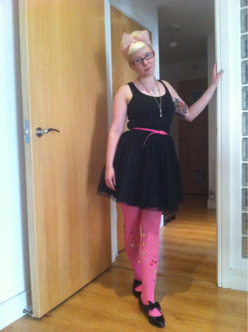 Wearing: DIY jewelled tights, net skirt, primark vest, belt from a dress I bought years ago, boyfriends bone necklace, star trek necklace and of course my office flats!  Hair: beehive, pink scarf  Feeling: pretty pleased with my jewelled tights! I think they need more jewels though… And I quite fancy jewelling all different coloured pairs too! Anyone else have any DIY clothing projects they can suggest?