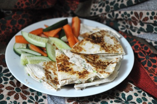 "hipsterfood:  white bean quesadillas i don't know how ""healthy"" this meal is, but it's making me feel pretty good! you can use this white bean mixture as a dip, a sandwich spread, or whatever else you come up with. it's sort of like a hummus, but thicker. try this, it's sooooo delicious! for the bean mixture: cook a batch of white beans (aka navy beans.) they can be either dried or canned, doesn't matter. just keep them warm when you're done cooking. put some (a little less than two cups) inside a food processor with a splash of soy milk, a couple of teaspoons of tahini, a hefty pinch of salt, a handful of chopped garlic scapes (or scallions), and a light sprinkle of brown sugar. i also added in a handful of fresh thyme, but it's optional. process until it's smooth and creamy, about 5 minutes. add in any additional salt if you want it, but keep in mind that the flavor will develop more if/when you store it in the refrigerator overnight. (which i suggest you do, it really makes it taste fantastic.) for the quesadilla: get out two burrito tortillas. (if you're making it for just yourself, use one burrito tortilla and fold it over, or use two taco tortillas for a smaller size.) brush one side of each with olive oil.  place one, oil side down, on a flat pan.  spread out the bean mixture onto the tortilla, then turn the heat on, to about medium-low.  place the second tortilla on top, and let it cook for a minute or two. using one or two large spatulas, and some dexterity, flip the quesadilla over and let it cook for another couple of minutes.  take off the pan when both sides are golden brown, and slice with a sharp knife.  amazing, right? a quesadilla that doesn't need cheese to make it stick together. if only any place we ate out at believed us when we say this is possible. serve hot with some cold fresh vegetables. i know you'll like this, so try it!"