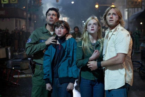 Super 8, written and directed by JJ Abrams. (left to right) Kyle Chandler, Joel Courtney, Elle Fanning, and Ron Eldard.